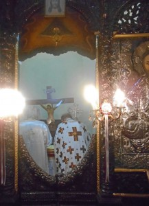 Priests behind the iconostasis.