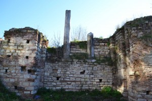 Remnants of a colonnade two stories above the chapel