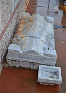 The Byzantine sarcophagus and impost capital in the grounds of the Orthodox church.