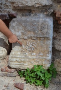 Roman stone in the wall of Le Chateau restaurant