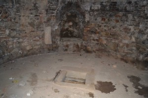 The hole in the floor through which the sacred spring may have been accessed